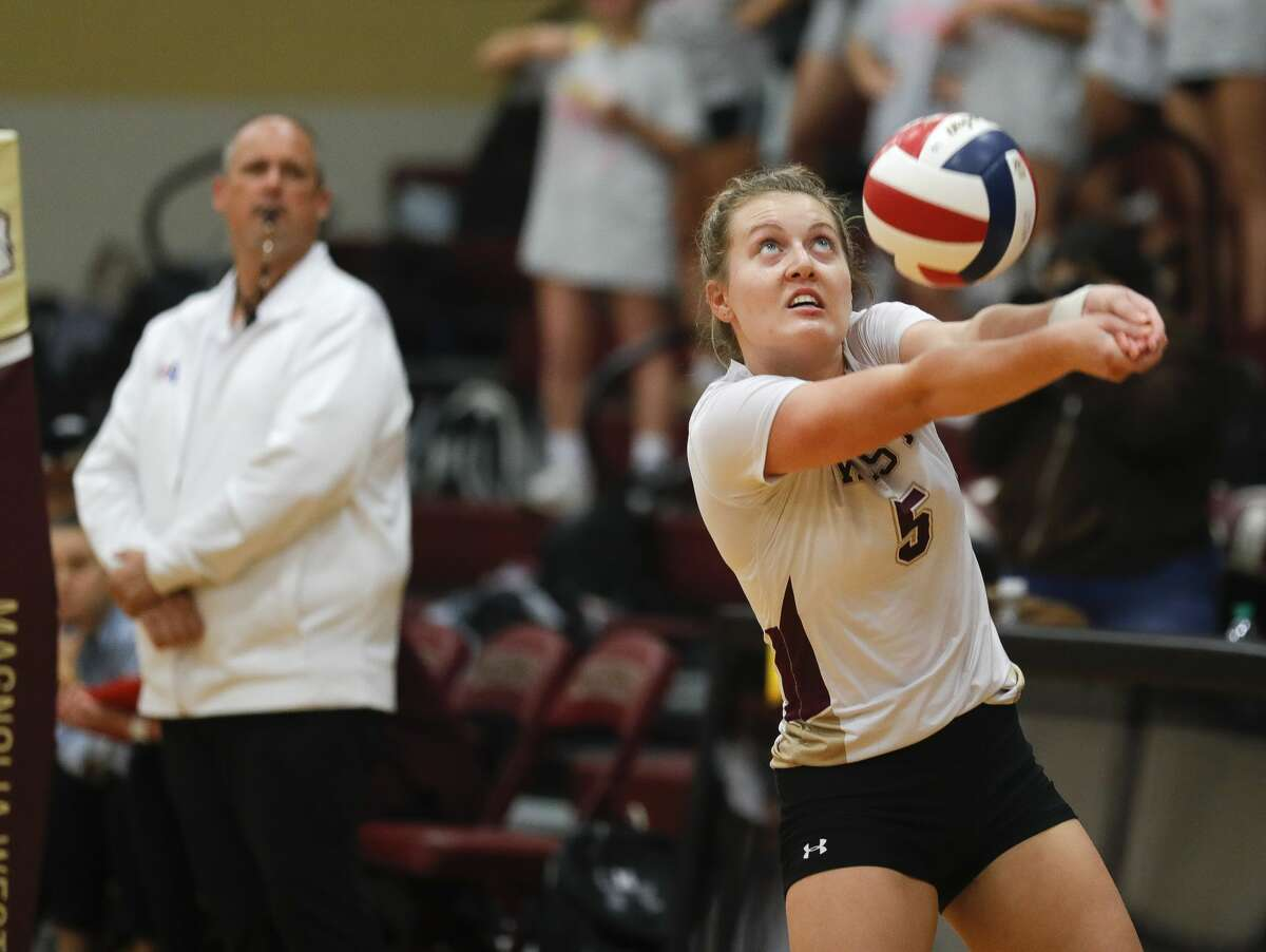 Magnolia West's Holly Windrum returns a hit during the third set of a District 19-5A high school volleyball match at Magnolia West High School, Tuesday, Sept. 21, 2021, in Magnolia.