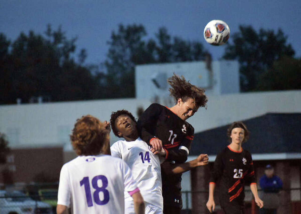 Edwardsville's Ben Mathews, right, goes up for a header over Collinsville's Jaylen Wade during the first half of Tuesday's game inside the District 7 Sports Complex.