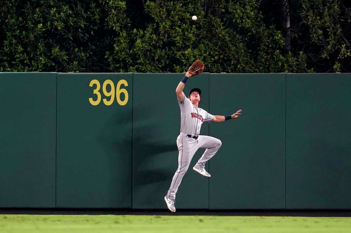 Houston Astros center fielder Jake Meyers makes a leaping catch on a pop fly by Los Angeles Angels' Kean Wong during the sixth inning of a baseball game Tuesday, Sept. 21, 2021, in Anaheim, Calif. (AP Photo/Marcio Jose Sanchez)