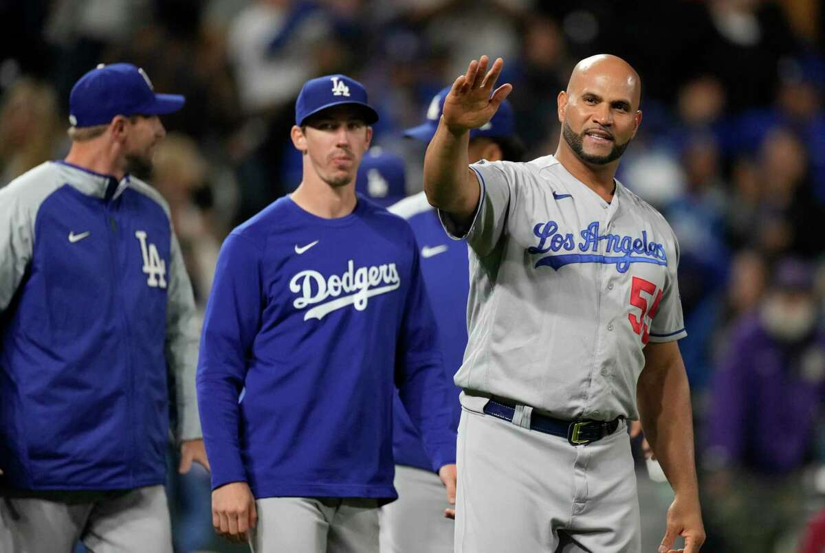 The Dodgers' Albert Pujols waves to fans in Denver after driving in the go-ahead run in the 10th inning.