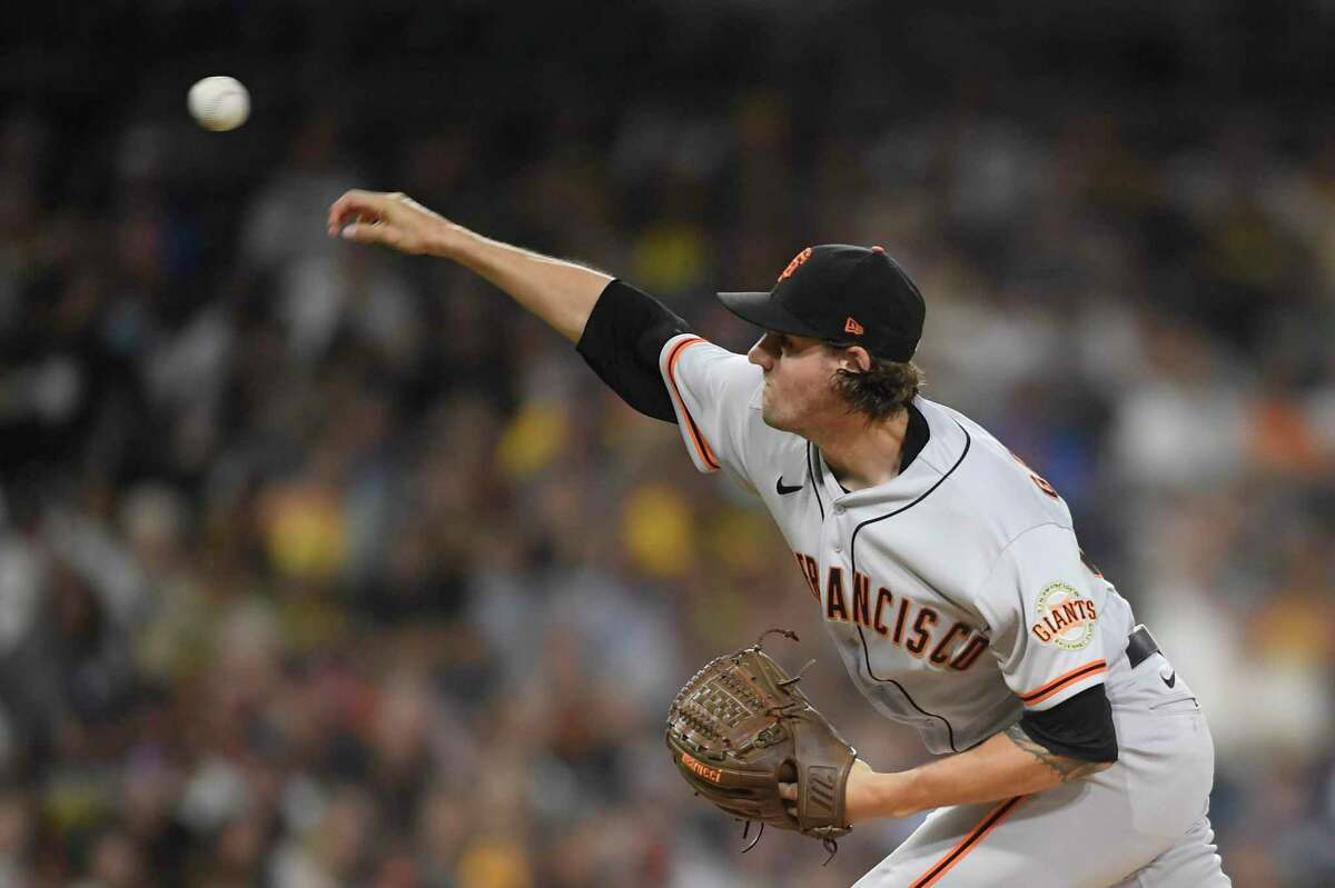 SAN DIEGO, CA - SEPTEMBER 21: Kevin Gausman #34 of the San Francisco Giants pitches during the first inning of a baseball game against the San Diego Padres at Petco Park on September 21, 2021 in San Diego, California. (Photo by Denis Poroy/Getty Images)