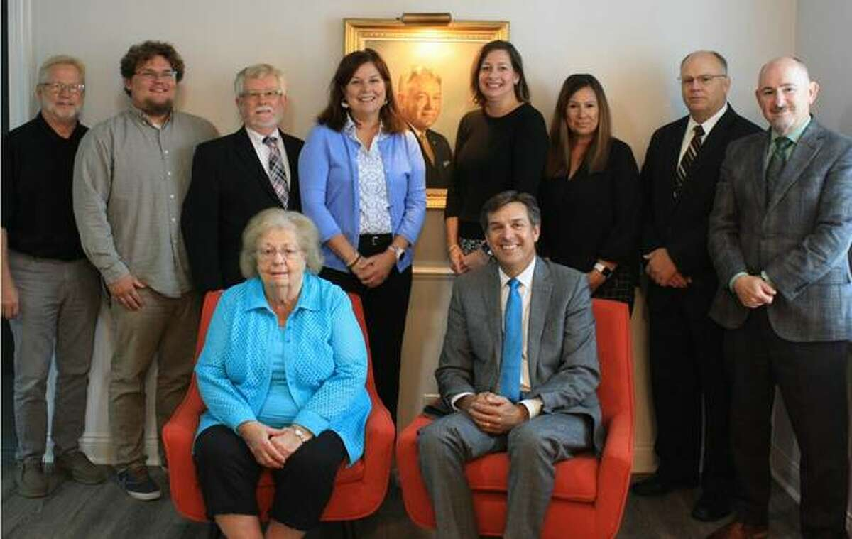 Gent Funeral Home has been named the September 2021 RiverBend Growth Association Small Business of the Month. Pictured from left are Jim Eppel, Sam Stemm, Larry Qualls, Laura Bowles Bosse', (portrait of the founder, Ralph A. Gent) Louise Bowles Jacoby, Dawn Bowles, John Eads and Chris Wooldridge; seated are Joanne Gent Bowles and Ralph Gent Bowles.