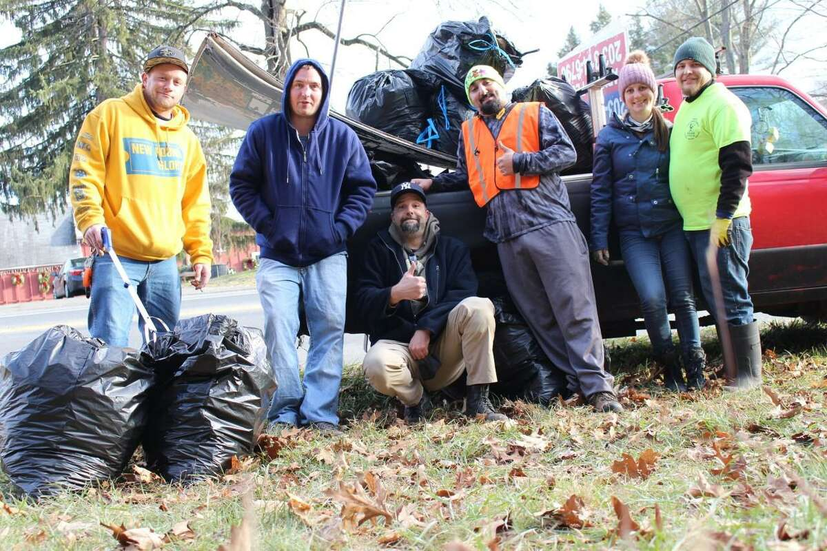 Volunteers with the Shelton Clean-Up Project after a work session along Bridgeport Avenue.