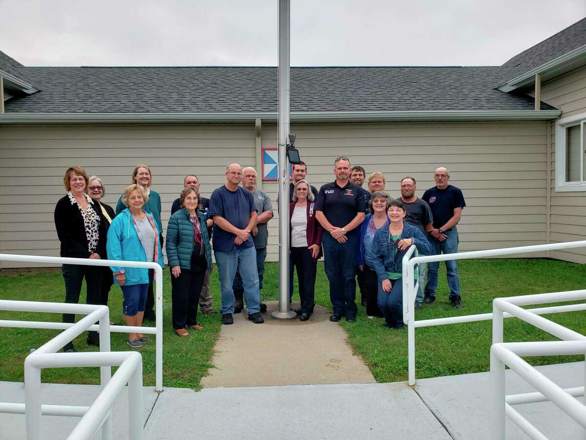 Thisyear's recipient of a flag commemorating Patriots Day was the Colfax TownshipFire Department including members pictured above:Chief Chuck Smalley; Assistant Chief Mike Miller; Charles Miller, Cody Maneke, Mike Maneke, Walker Weipert, James Cass, Dan Elliott and Ryan Pranger. Chapter members are Bev Rothenberger, Sallie Wyman, Kate Wyman, Liz LaBatt, Coleen Dice, Diana Korcal, Kim Brooks, and guest Julie Avnit. (Submitted photo)