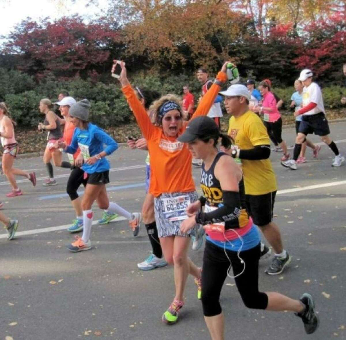 Ridgefield resident Claire Gladstone is preparing to run her 100th marathon in November. Pictured, Gladstone runs for Fred's Team during the New York City Marathon in 2013.