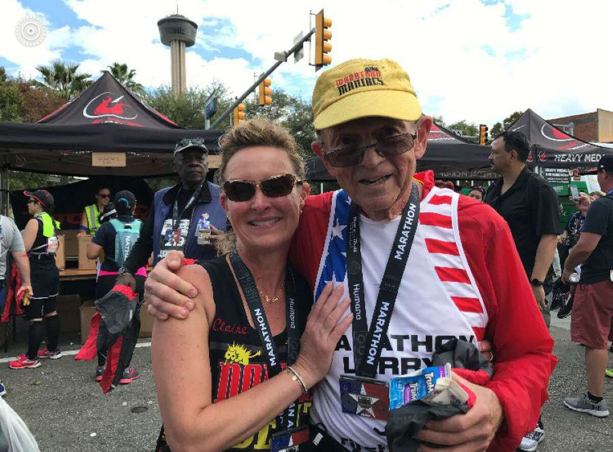 Gladstone's constant marathoning is less about how fast she finishes and more about the people she meets. Pictured, Gladstone with her friend Larry Macon in San Antonio, Texas, where he marked his 2,000th marathon.