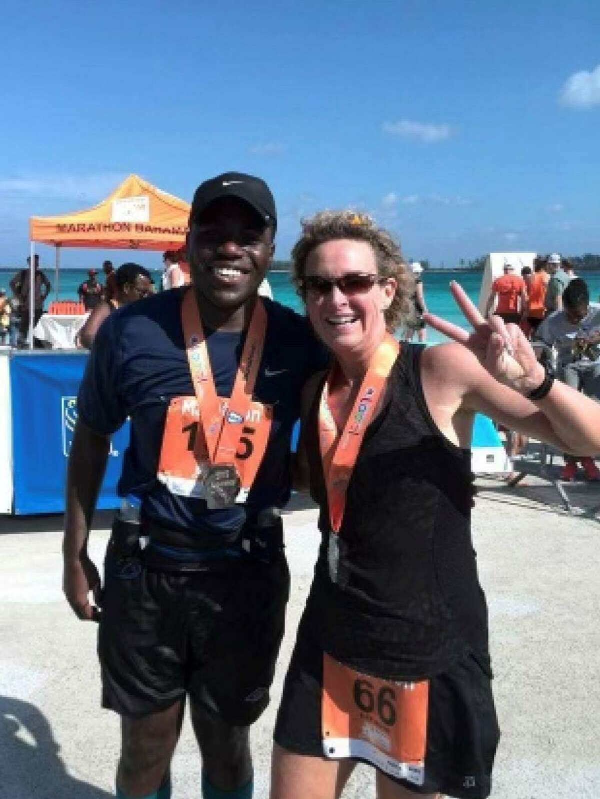 Gladstone ran her qualifying run for the Marathon Maniacs club in the Bahamas in 2016. During the run she met David, pictured, whom she helped shoulder through the sweltering Bahamian heat.