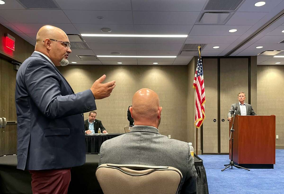 Michael Rosario, the business manager for a plumbers & pipe fitters local, praised Lamont on his handling of the pandemic, then challenged him over a licensing issue.
