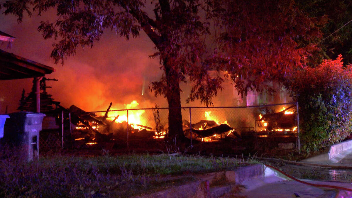 A North Side home was destroyed and two others damaged from a fire Wednesday morning.