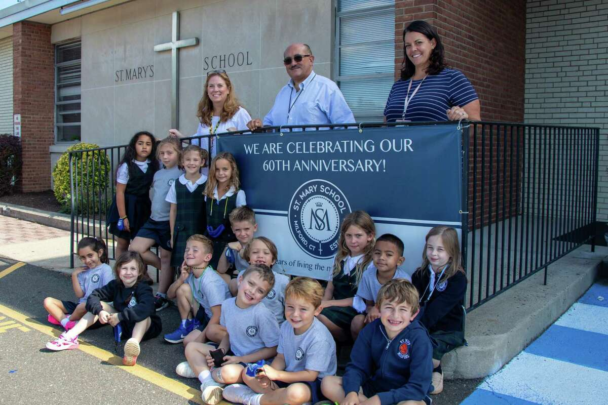 Saint Mary's School is celebrating its 60th anniversary. Pictured, along with Emily Nolan's first-grade class, is (from left) April Bryant, marketing/enrollment; Missy Dubin, assistant principal and Dominic Corraro, principal.