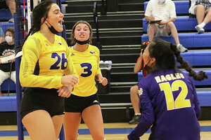 CM's Camryn Gehrs (26), Maddie Brueckner (3) and Ella Middleton (12) celebrate a point during an August match at the Roxana Tournament. On Tuesday, the Eagles celebrated a MVC victory over Triad that pushed their record to 19-3-1.