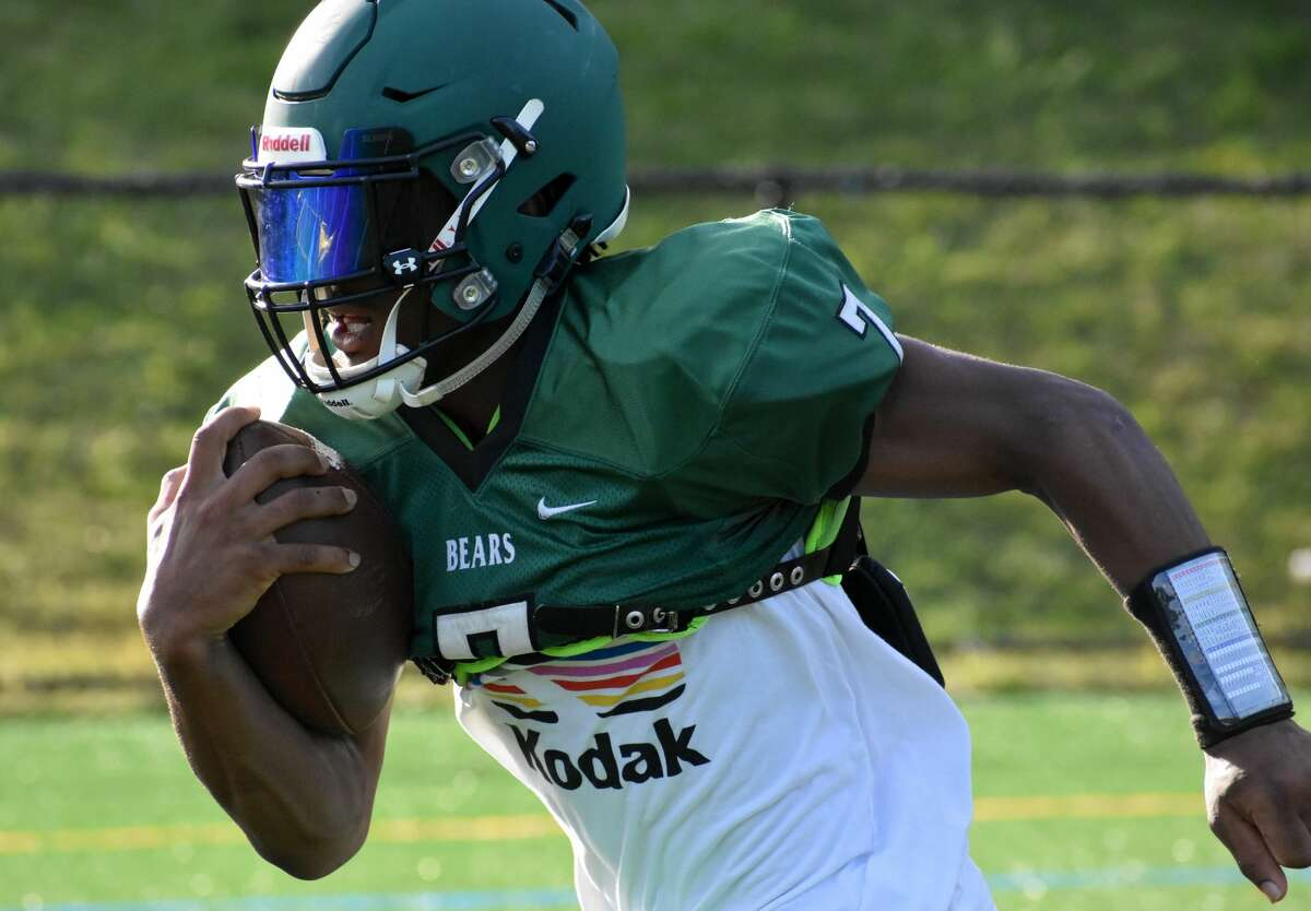 Norwalk senior running back Cam Edwards takes a handoff during practice at Nathan Hale Middle School, Norwalk on Tuesday, Sept. 21, 2021.