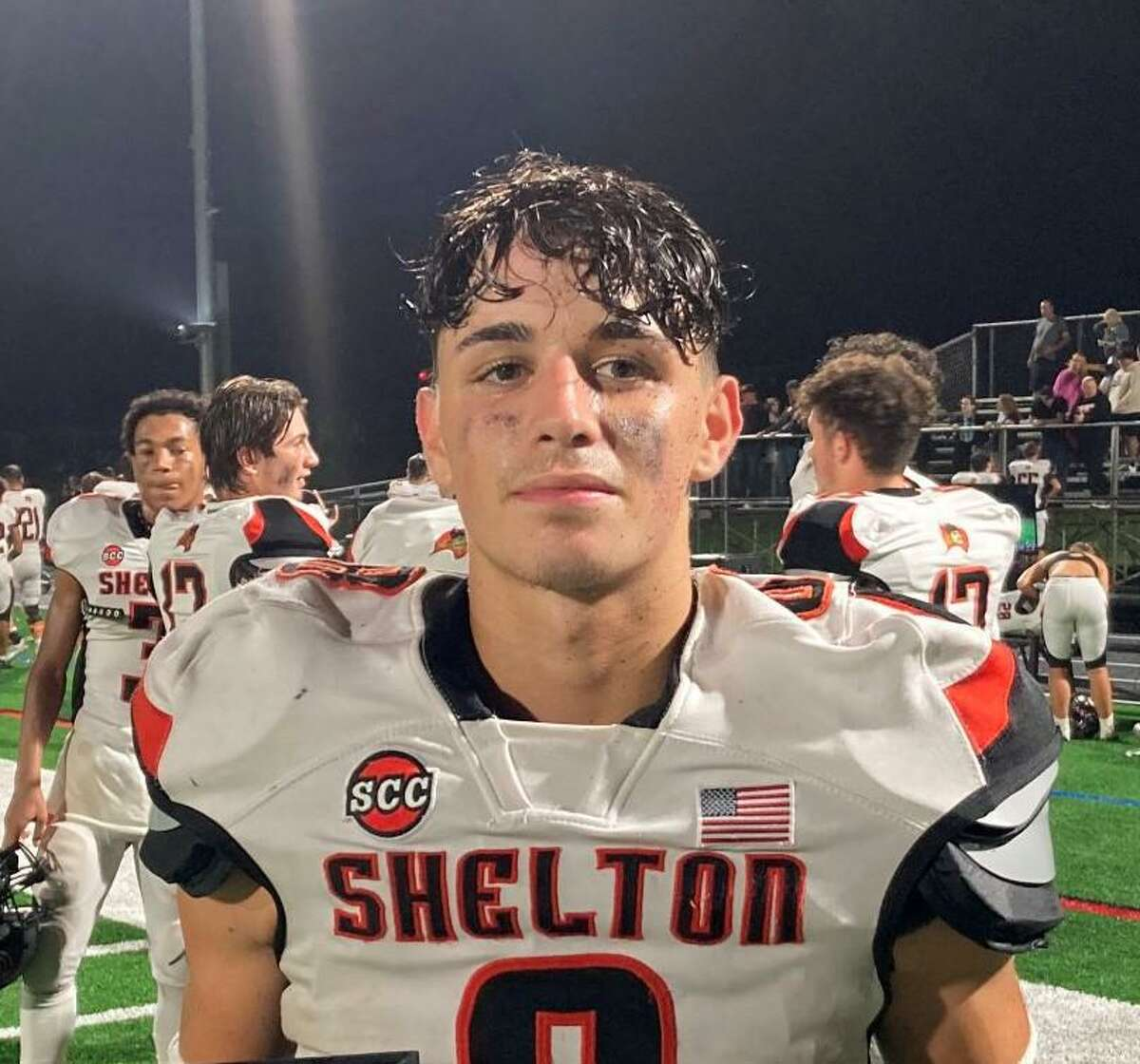 Shane Santiago ran for two touchdowns when Shelton defeated Amity 14-0.