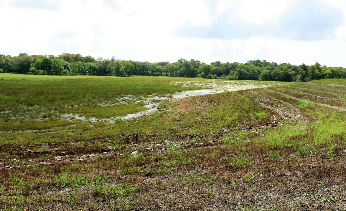 At the former Imperial Estates subdivision in Friendswood a vast detention area at the confluence of Mary's and Clear creeks has been carved out of the landscape. A debris line shows how high water reached in a recent rain event.