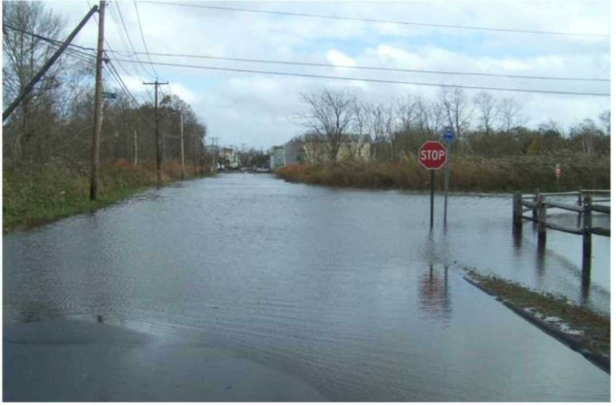 Floodwaters rise at Morse Avenue and Blohm Street along Old Field Creek during Superstorm Sandy.