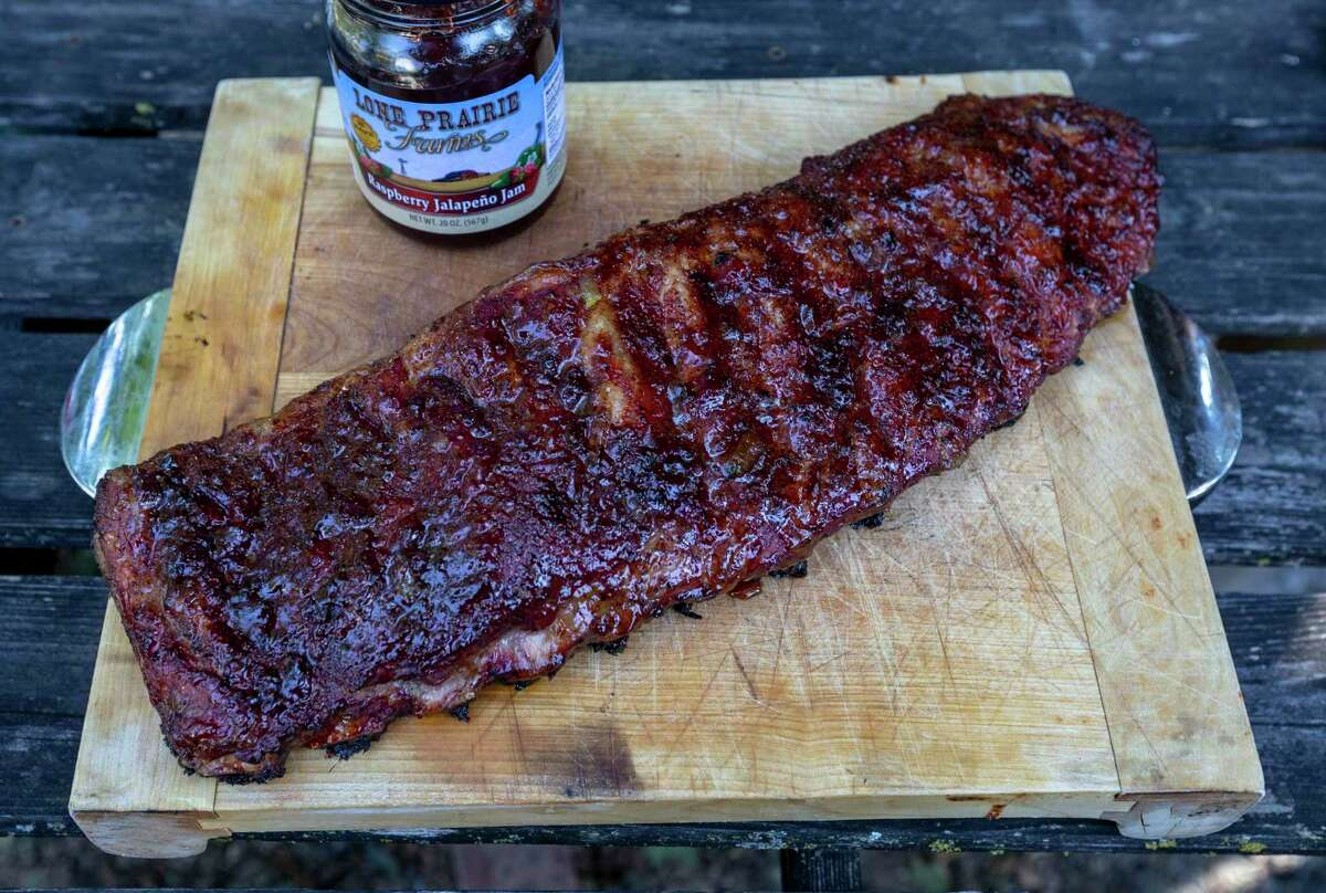 Finished pork ribs mopped with raspberry jalapeño jam while cooking are seen at Chuck's Food Shack.