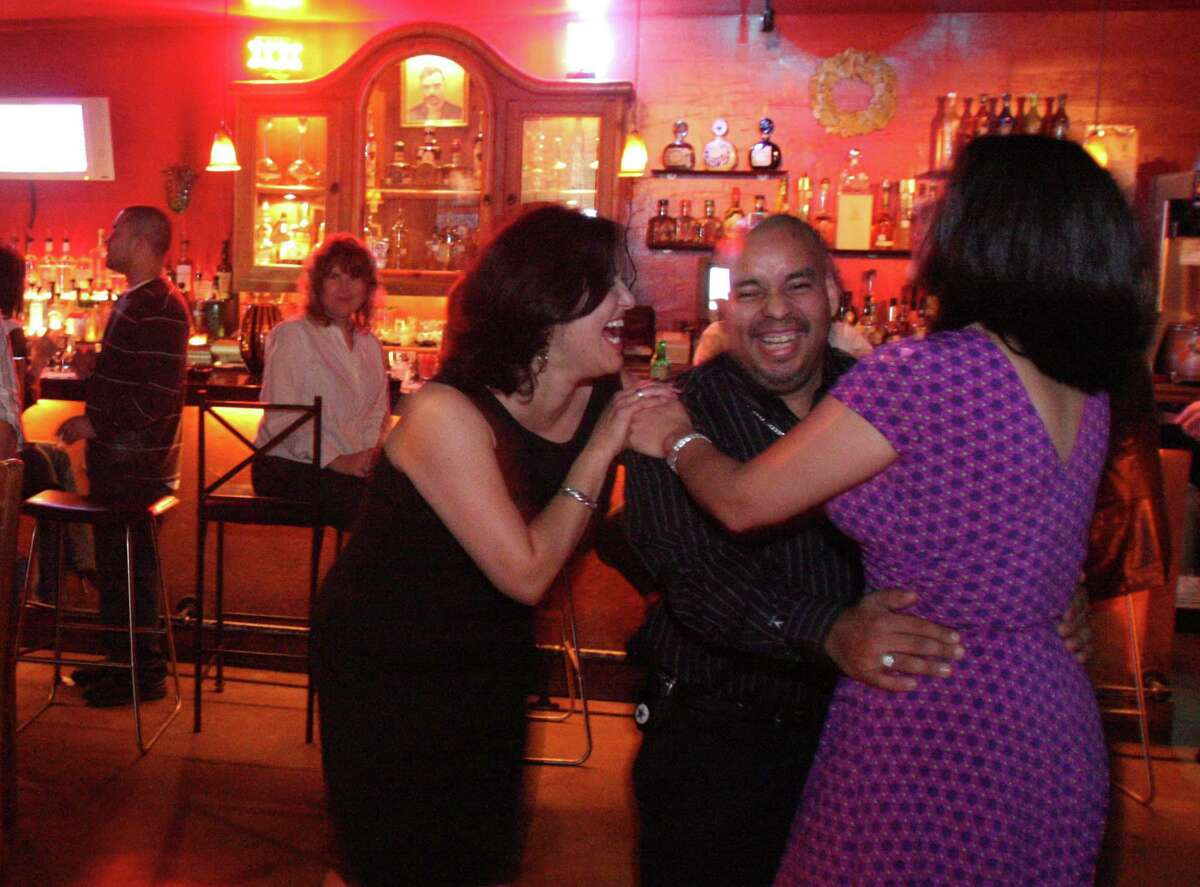 Customers enjoy drinks at ¡Salud!, a Broadway tequila bar that closed Sunday.