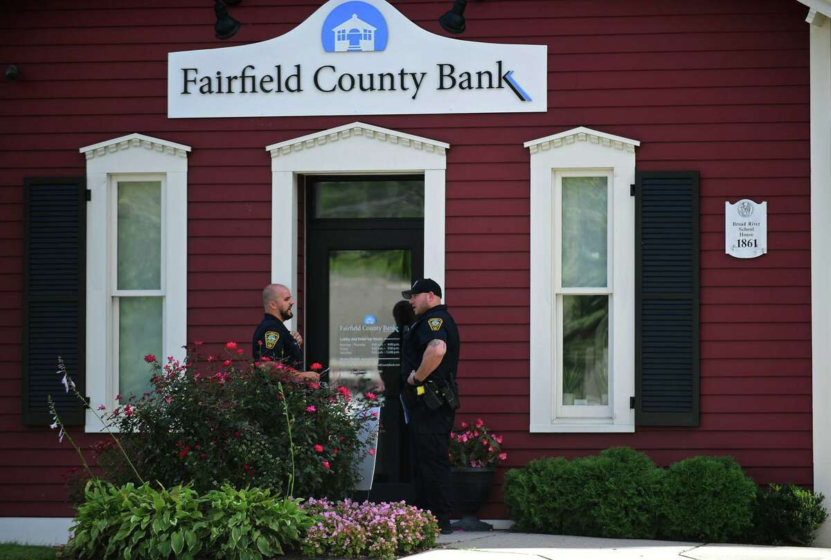 Norwalk police investigate a bank robbery at the Fairfield County Bank Tuesday, September 21, 2021, in Norwalk, Conn.