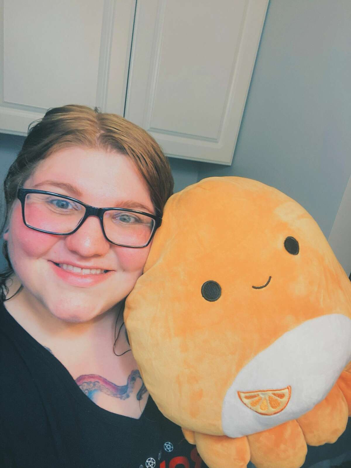 """Kayla Passmore, admin of the """"Connecticut Squishmallow Scavengers"""" Facebook group, with one of her favorite Squishmallows."""