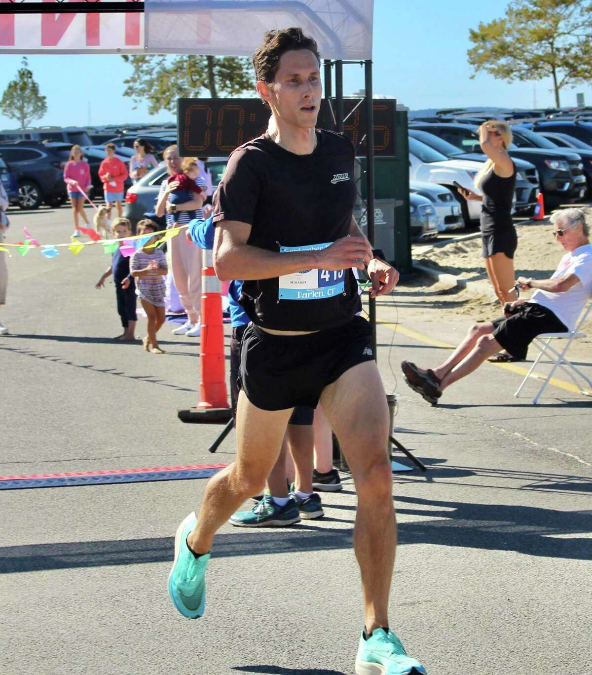 Patrick Dooley, of Stamford, was the first person to cross the five-mile finish line with a time of 26:47
