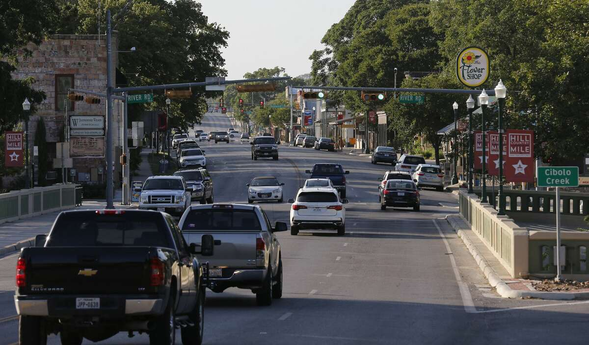 Traffic passes along Main Street in Boerne. In an effort to solve the region's traffic issues, officials are looking to divert traffic away from main roads that cut through downtown Boerne.