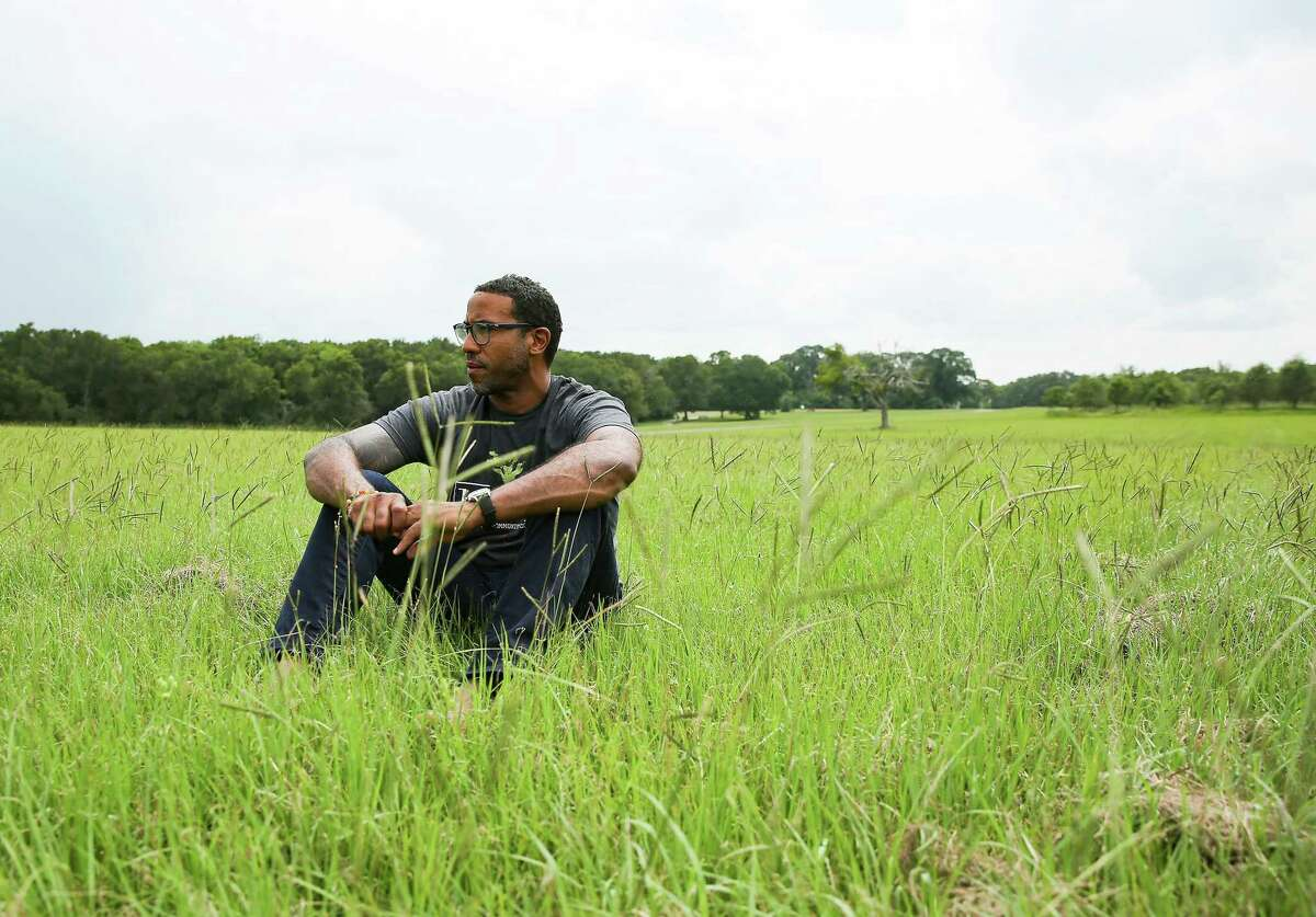 Top: Chef Chris Williams of Lucille's restaurant sits in a field in Fort Bend County where he will create a 10-acre produce farm. Above: