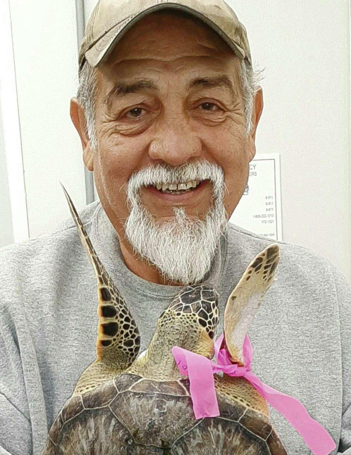 Carlos Rios gets a hug from a sea turtle.