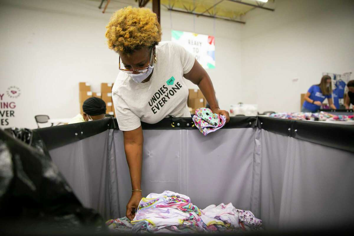 Volunteer Regina Maloy sorts girls underwear. This year, 105,000 students in nine states will receive a seven-pack.