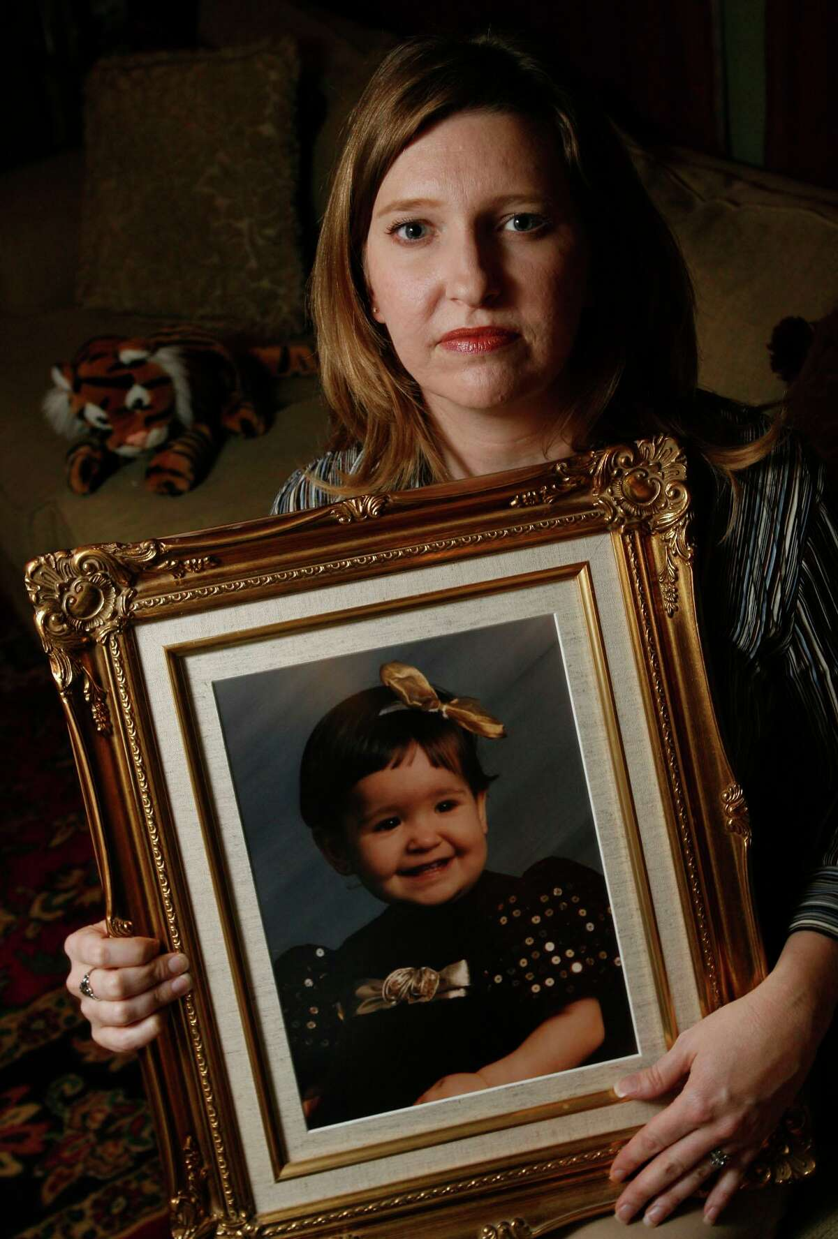Deana Hebert holds a photo of her daughter, 18-month-old daughter Bianca Lozano, in 2009. Texas Center for the Missing helped locate her in Mexico, 26 years after her father took her for a weekend visit in 1995 and never brought her back.