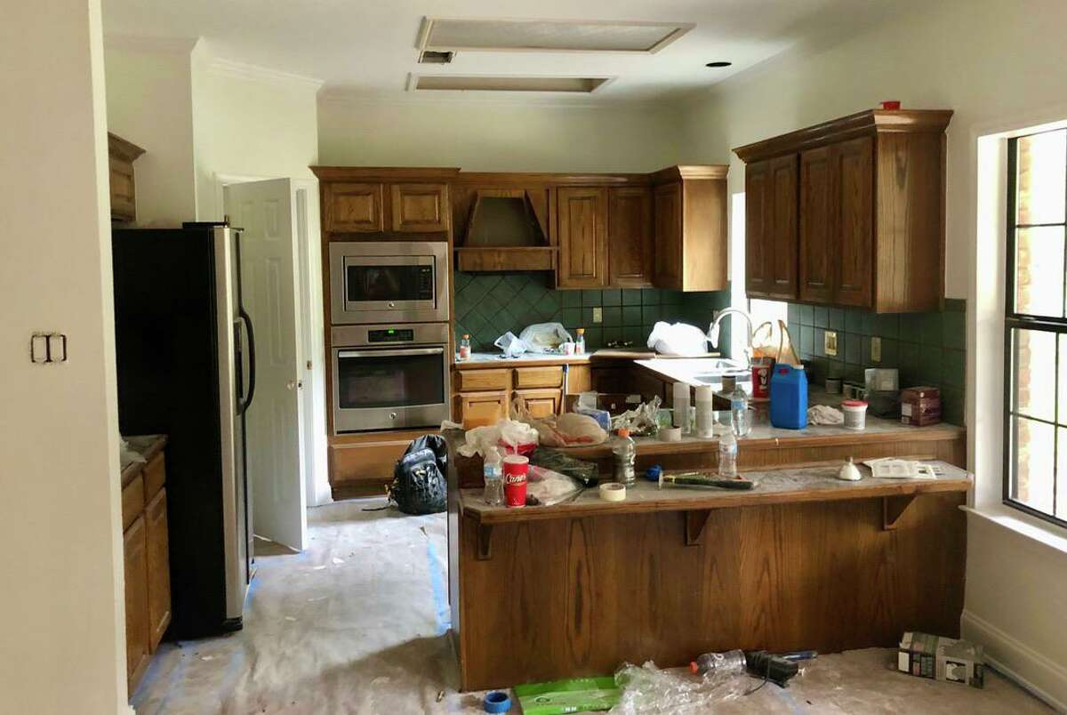 This is the view of Eddie and Chantal Rascon's tired mid-'90s kitchen just as the renovation began. The partial wall they had removed can be seen to the left and the traffic-impeding peninsula is visible on the right.