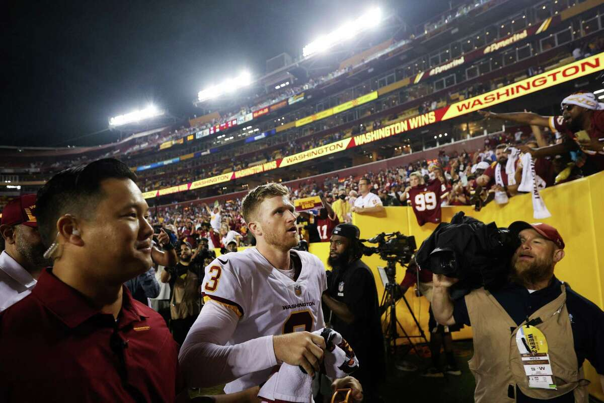 Dustin Hopkins (3) of the Washington Football Team exits the field following a 30-29 win over the New York Giants at FedExField on September 16 in Landover, Md.
