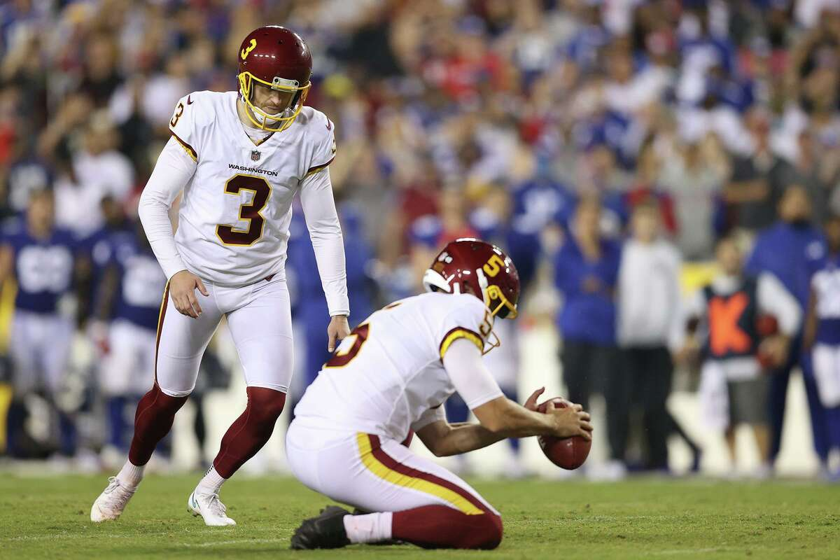Dustin Hopkins (3) of the Washington Football Team prepares to kick a 43-yard field goal to defeat the New York Giants at FedExField on September 16 in Landover, Md.