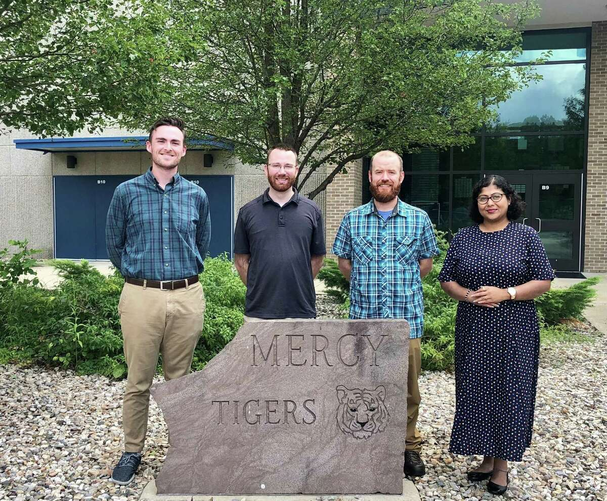 New faculty members Andrew Carroll, Liam Cahill, Justin Michaud and Sangita Ray.
