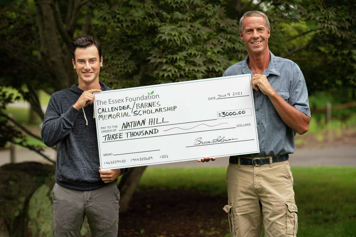 Scholarship winner Nathan Hill receiving a check from Jay Tonks, vice president of The Essex Foundation.