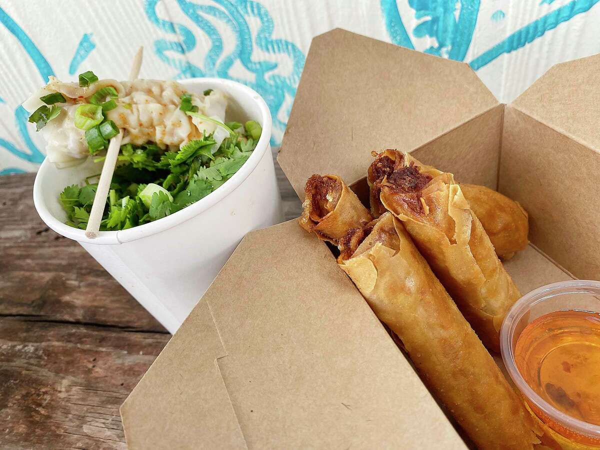 Pork dumplings called Aroy Bomb, left, and fried spring rolls with chicken and glass noodles are part of the menu at Aroy Ver, a Thai food trailer parked on Broadway north of the Pearl at Broadway News.