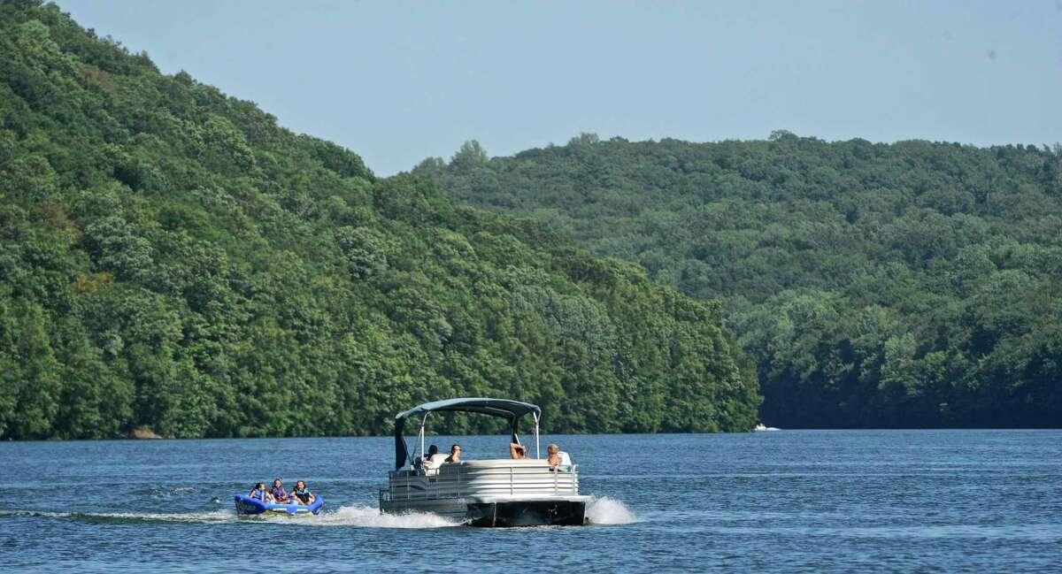 Ceci Schimenti, Michael Schimenti and Astrid Shay ride in a 3-person tube while being pulled by their grandparents boat on Lake Lillinonah. Mike and Lorraine Schimenti, of Brookfield, took visiting family out on the lake for an outing on Wednesday afternoon, July 27, 2016, in Brookfield and Bridgewater, Conn.