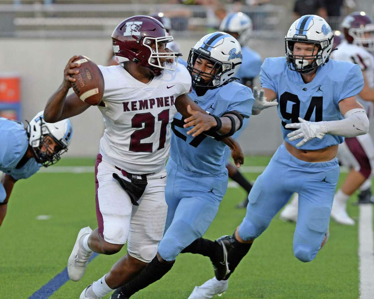 Javon Goss (21) of Kempner is pressured by Daymion Sanford (27) and Jacob Johnson (94) of Paetow during the second quarter of a District 10-5A-I football game between the Kempner Cougars and the Paetow Panthers on Saturday, September 18, 2021 at Legacy Stadium, Katy, TX.