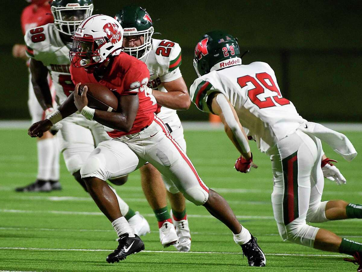 Katy running back Seth Davis, left, runs past The Woodlands defensive back Caden Miller (29) for a touchdown during the first half of a high school football game against The Woodlands, Thursday, Sept. 16, 2021, in Katy.