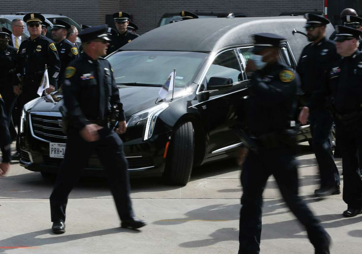 """Houston Police Chief Troy Finner, HPD commanders and officers escort the body of fallen Senior Police Officer William """"Bill"""" Jeffrey from the Harris County Institute of Forensic in Houston on Wednesday, Sept. 22, 2021."""