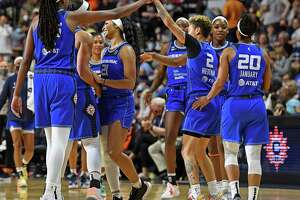Connecticut Sun players celebrate a run against the Atlanta Dream during a WNBA basketball game Sunday, Sept. 19, 2021, in Uncasville, Conn.