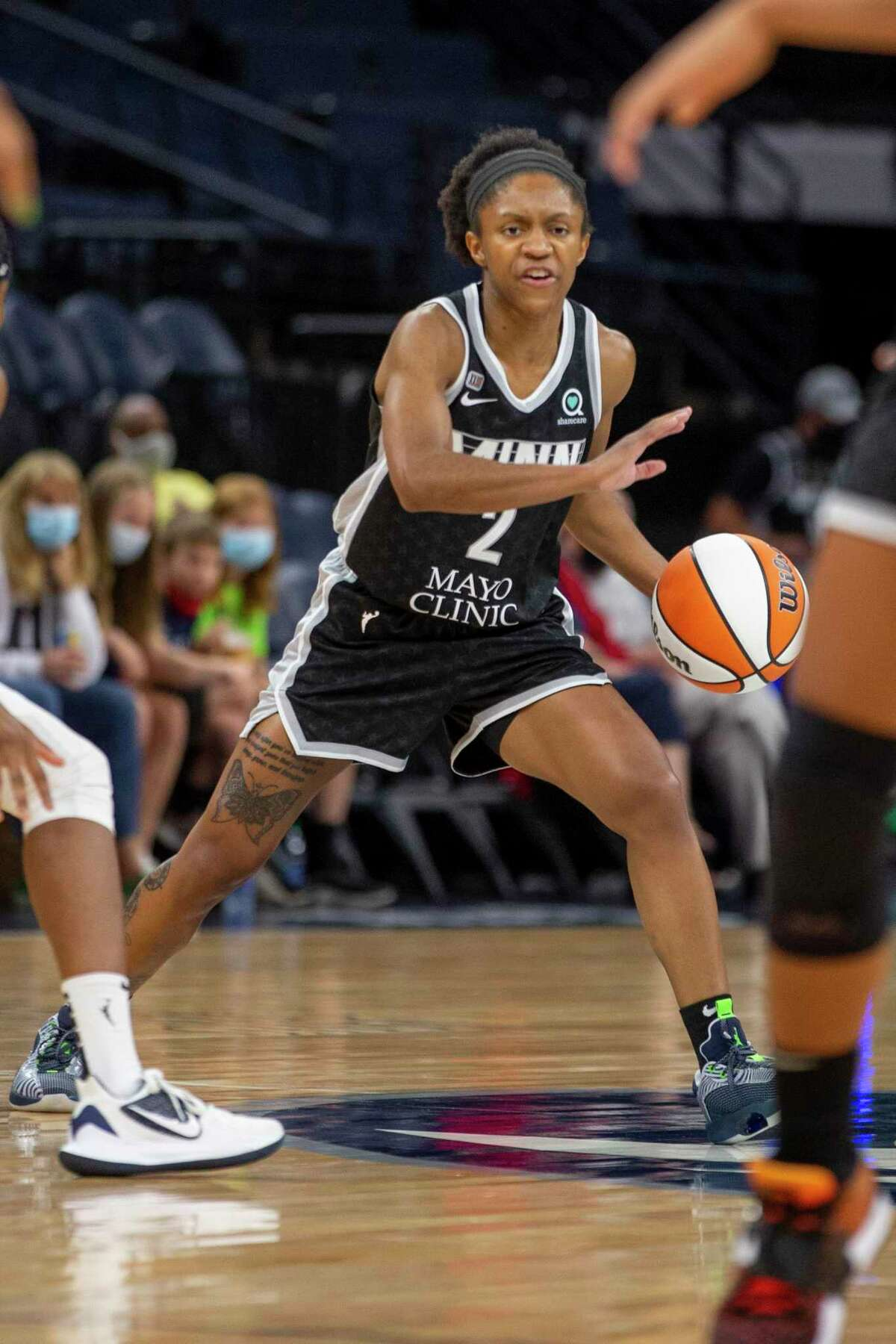 Minnesota Lynx guard Crystal Dangerfield (2) brings the ball up court against the Washington Mystics in the first quarter of a WNBA basketball game Saturday, Sept. 4, 2021, in Minneapolis. The Lynx won 93-75.
