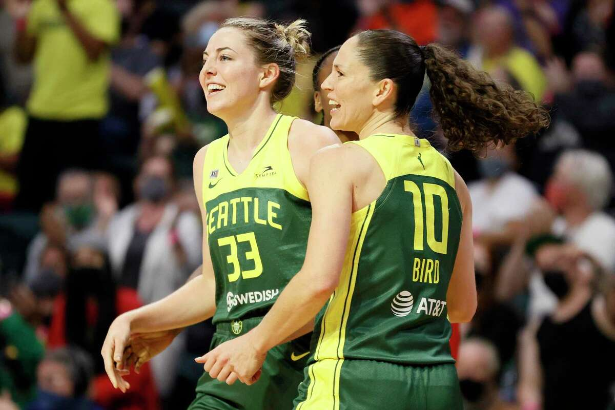Katie Lou Samuelson #33 and Sue Bird #10 of the Seattle Storm react during the third quarter against the Washington Mystics at Angel of the Winds Arena on September 07, 2021 in Everett, Washington.