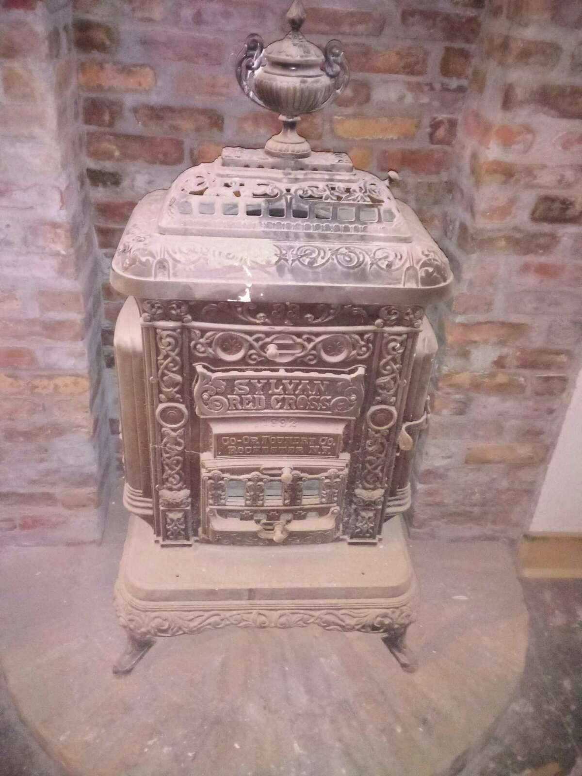 Carlo and Michelle Pulixi of New Hartford plan to open Geppetto, an Italian steak house and bar, at 26 E. Main St., the former site of O'Connor's Public House. The couple has spent the summer renovating the space with old-world decor and using treasures found inside, such as this old stove.