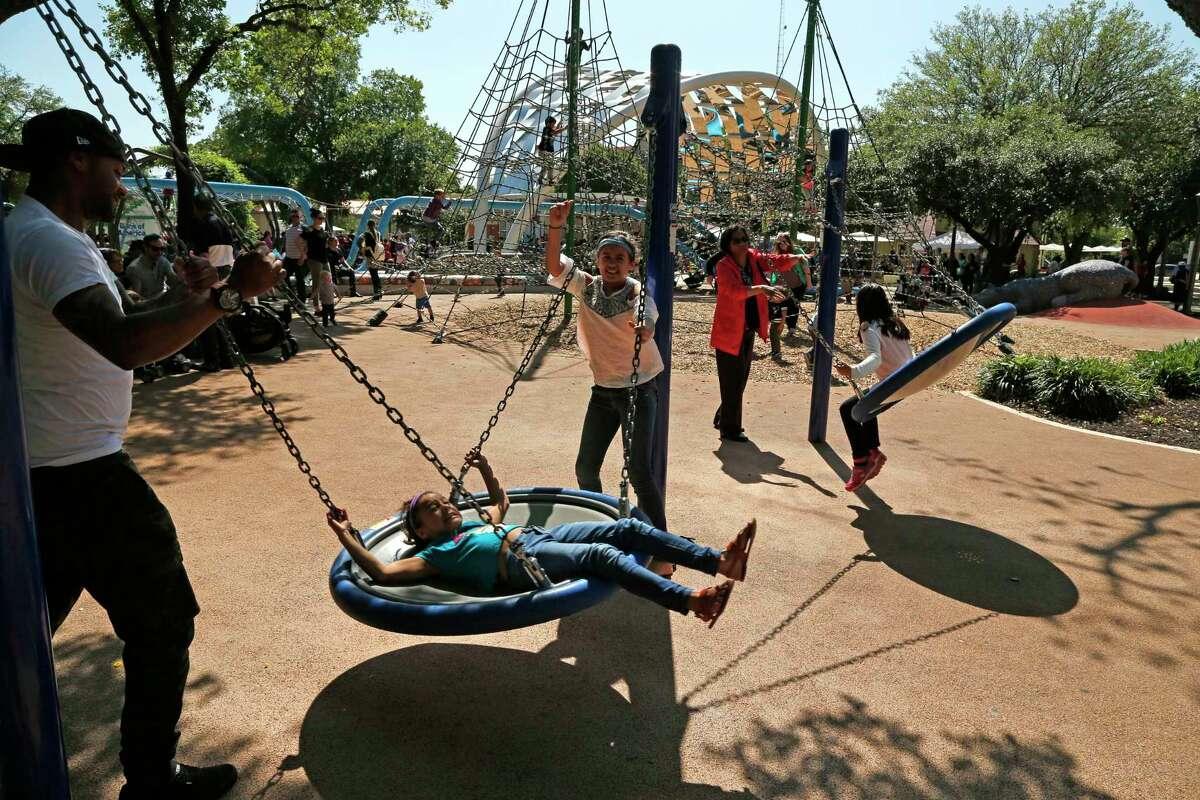Children play at Hemisfair in 2018.