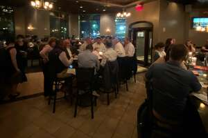 The dining room at dp: An American Brasserie in Albany filled up instantly when an unannounced party of 33 walked in on Tuesday, Sept. 21, 2021. Most restaurants always prefer reservations for parties larger than about eight people but will accommodate if possible.