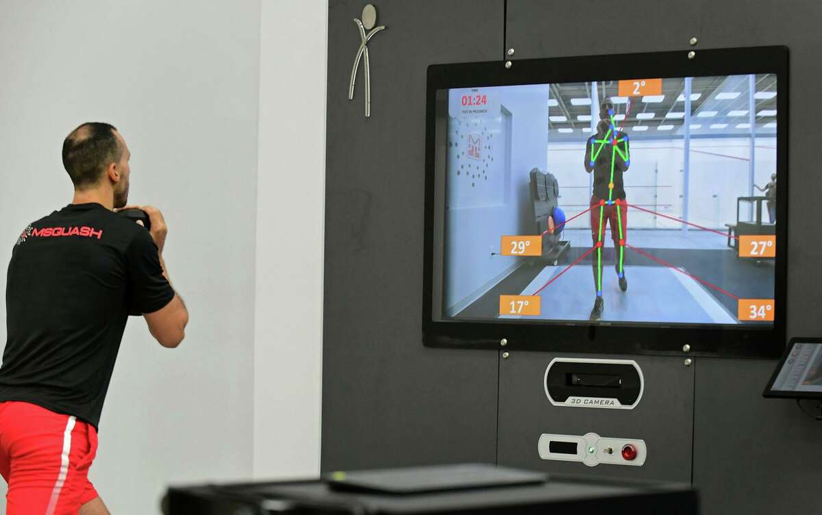 MSquash coach Omar El-Kashel trains with a TecnoBody D-Wall system at the new squash center in South Norwalk, Conn., on Wednesday, Sept. 22, 2021.