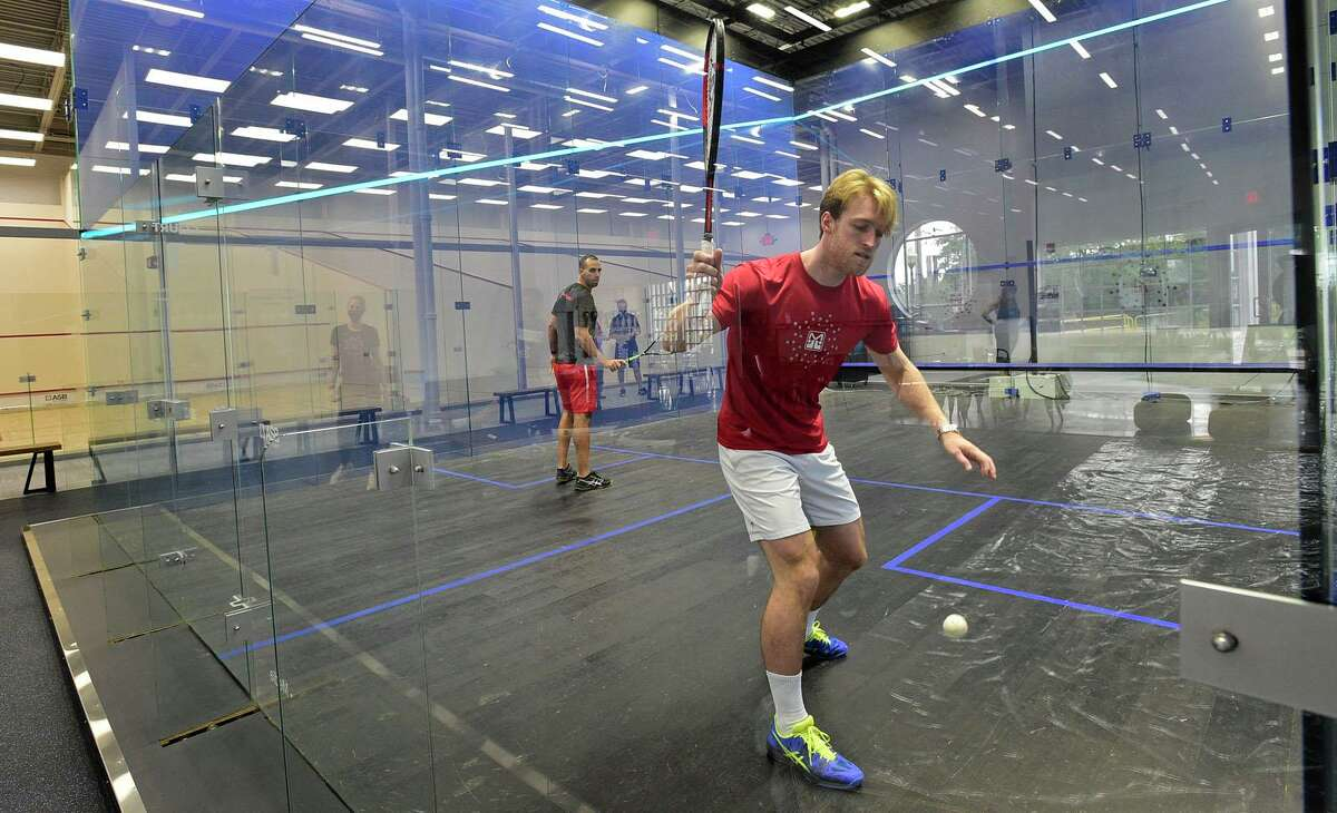 MSquash SoNo coach Ollie Holland practices at the new squash facility in South Norwalk on Wednesday, Sept. 22, 2021.
