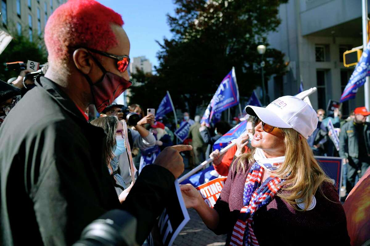 Protesters with opposing viewpoints face off in 2020 in Philadelphia. A reader says political division could sink this nation.