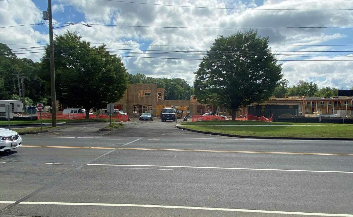 """The Star Deluxe Branford apartment complex on East Main Street is under construction. Town officials say the municipality's """"hometown"""" feel attracts housing developers to Branford."""