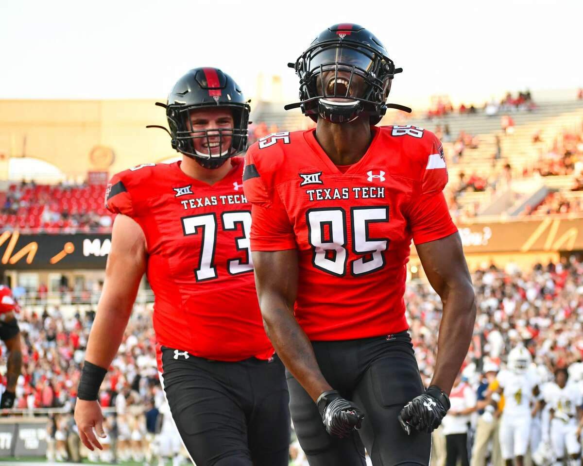 Trey Cleveland (85) and Dawson Deaton will try to help the Texas Tech football team come out on top on Saturday against Texas.